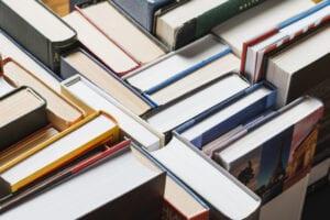 books-randomly-stacked-shelf_23-2147846041